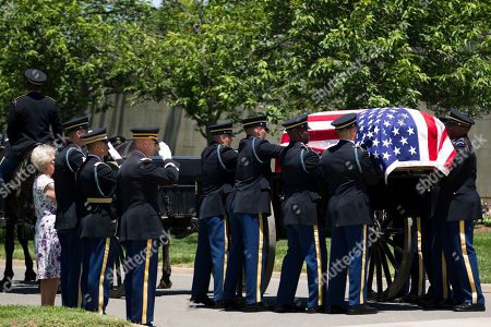 An Army team carries the casket of U.S. Army Air Forces 2nd Lt. Robert R. Keown to the burial site at Arlington National Cemetery in Arlington, Va., on . Keown was piloting his P-38 aircraft when it crashed in Papua New Guinea in 1944