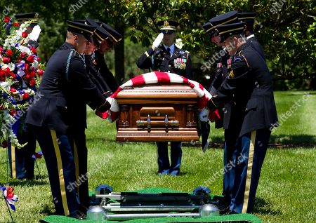 Stock Picture of An Army team carries the casket of U.S. Army Air Forces 2nd Lt. Robert R. Keown to the burial site at Arlington National Cemetery in Arlington, Va., on . Keown was piloting his P-38 aircraft when it crashed in Papua New Guinea in 1944