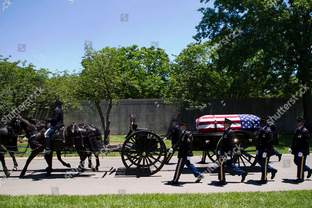 A caisson carries the casket of U.S. Army Air Forces 2nd Lt. Robert R. Keown to the burial site at Arlington National Cemetery in Arlington, Va., on . Keown was piloting his P-38 aircraft when it crashed in Papua New Guinea in 1944