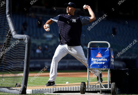 Former New York Yankees pitcher Andy Pettitte throws during batting practice prior to a baseball game against the Tampa Bay Rays, in New York