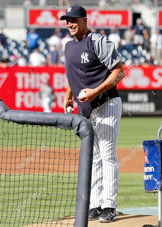 Former New York Yankees pitcher Andy Pettitte throws during batting practice prior to a baseball game against the Tampa Bay Rays, in New York. The Yankees won 4-3