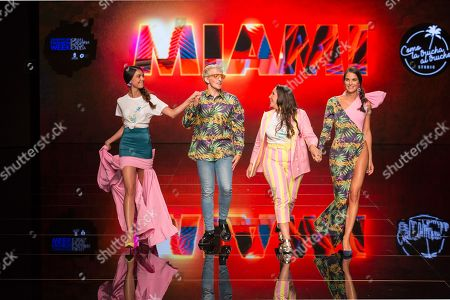 Designers with Paula Boluda (L) and Marina Garcia (R) on catwalk