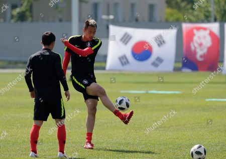 South Korea's Kim Shin-wook controls the ball during a training session of South Korea at the 2018 soccer World Cup at the Spartak Stadium in Lomonosov near St. Petersburg, Russia