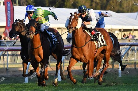 Stock Picture of Jockey Michael Cahill (right) riding #10 Magic Alibi, wins race nine, the Sky Gai Waterhouse Classic during the 2018 Ipswich Cup Day at the Ipswich Turf Club in Ipswich, Australia, 16 June 2018.