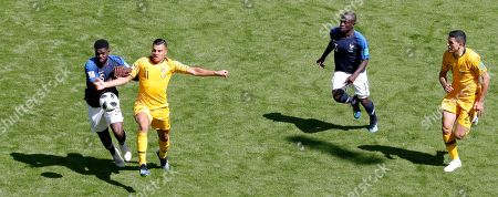 Samuel Umtiti of France and Andrew Nabbout of Australia in action during the FIFA World Cup 2018 Group C preliminary round soccer match between France and Australia in Kazan, Russia, 16 June 2018.