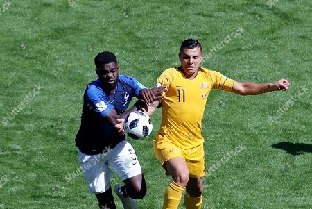 France's Samuel Umtiti, left, duels for the ball with Australia's Andrew Nabbout during the group C match between France and Australia at the 2018 soccer World Cup in the Kazan Arena in Kazan, Russia