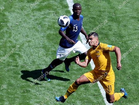 Australia's Andrew Nabbout, right, jumps for the ball with France's Ngolo Kante during the group C match between France and Australia at the 2018 soccer World Cup in the Kazan Arena in Kazan, Russia
