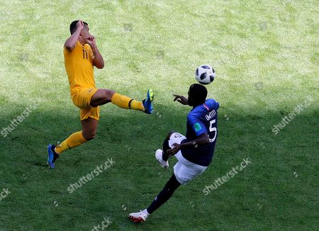 Australia's Andrew Nabbout, left, duels for the ball with France's Samuel Umtiti during the group C match between France and Australia at the 2018 soccer World Cup in the Kazan Arena in Kazan, Russia