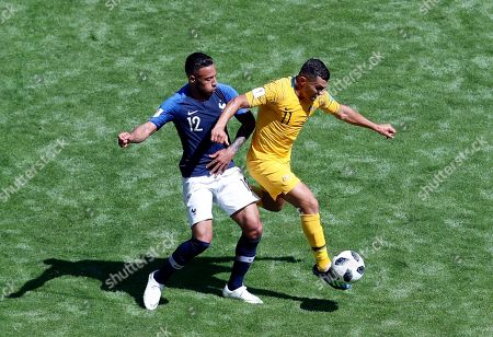 France's Corentin Tolisso, left, duels for the ball with Australia's Andrew Nabbout during the group C match between France and Australia at the 2018 soccer World Cup in the Kazan Arena in Kazan, Russia