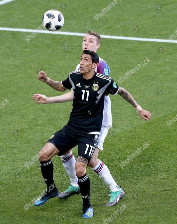 Stock Image of Angel Di Maria of Argentina and Birkir Mar Saevarsson of Iceland