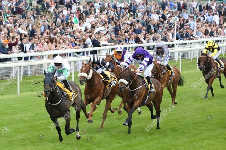 Stock Picture of ABOVE THE REST (1) ridden by jockey Ben Curtis and trained by David Barron winning The JCB Handicap Stakes over 7f (£40,000) during the Macmillan Charity Raceday at York Racecourse, York. Picture by Mick Atkins