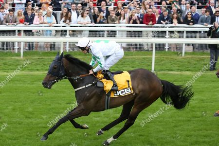 Stock Photo of ABOVE THE REST (1) ridden by jockey Ben Curtis and trained by David Barron winning The JCB Handicap Stakes over 7f (£40,000)  during the Macmillan Charity Raceday at York Racecourse, York. Picture by Mick Atkins