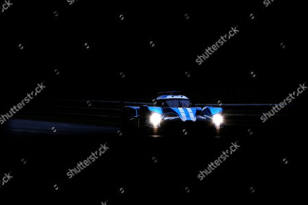 Stock Photo of CEFC TRSM Racing in a Ginetta G60 LT P1 Mecachrome with Oliver Rowland of Great Britain, Alex Brundle of Great Britain and Oliver Turvey of Great Britain in action at nightfall during the Le Mans 24 Hours race in Le Mans, France, 16 June 2018.