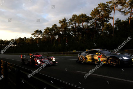 Rebellion Racing in a Rebellion R13 Gibson (L) with Andre Lotterer of Germany, Neel Jani of Switzerland and Bruno Senna of Brasil and Aston Martin Racing in Aston Martin VANTAGE with Paul Dallla Lana, Pedro Lamy and Mathias Lauda in action at nightfall during the Le Mans 24 Hours race in Le Mans, France, 16 June 2018.