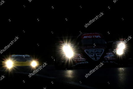 Rebellion Racing in a Rebellion R13 Gibson (R) with Andre Lotterer of Germany, Neel Jani of Switzerland and Bruno Senna of Brasil in action at nightfall during the Le Mans 24 Hours race in Le Mans, France, 16 June 2018.
