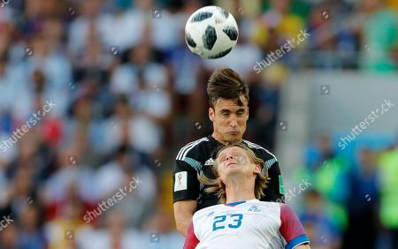 Stock Picture of Iceland's Samuel Fridjonsson, below, challenges for the ball with Argentina's Nicolas Tagliafico during the group D match between Argentina and Iceland at the 2018 soccer World Cup in the Spartak Stadium in Moscow, Russia