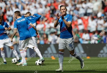 Iceland's Olafur Skulason applauds to the fans when warming up prior to the group D match between Argentina and Iceland at the 2018 soccer World Cup in the Spartak Stadium in Moscow, Russia