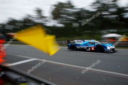 Stock Picture of The Ginette G60 LT P1 Mecachrome driven by Oliver Rowland, Alex Brundle and Oliver Turvey, three from Britain, drives past a yellow flag, during the 86th 24-hour Le Mans endurance race, in Le Mans, western France