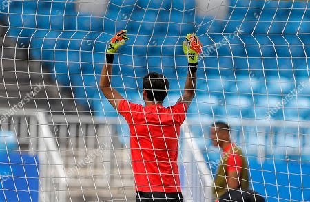 Costa Rica goalkeeper Leonel Moreira holds on to the net during Costa Rica's official training on the eve of the group E match between Costa Rica and Serbia at the 2018 soccer World Cup in the Samara Arena in Samara, Russia