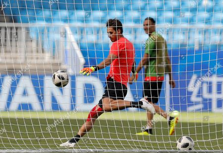 Costa Rica goalkeeper Leonel Moreira kicks a ball during Costa Rica's official training on the eve of the group E match between Costa Rica and Serbia at the 2018 soccer World Cup in the Samara Arena in Samara, Russia