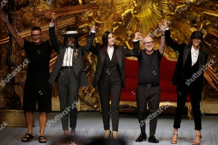 Stefano Gabbana, Naomi Campbell, Monica Bellucci, Domenico Dolce. Designer Stefano Gabbana, from left, model Naomi Campbell, actress Monica Bellucci and designer Domenico Dolce accept applause at the end of Dolce & Gabbana's men's 2019 Spring-Summer collection, unveiled during the Fashion Week in Milan, Italy