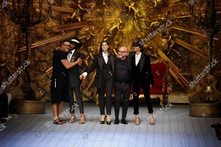 Stefano Gabbana, Naomi Campbell, Monica Bellucci, Domenico Dolce. Designer Stefano Gabbana, from left, model Naomi Campbell, actress Monica Bellucci, designer Domenico Dolce and model Marpessa Hennink accept applause at the end of Dolce & Gabbana's men's 2019 Spring-Summer collection, unveiled during the Fashion Week in Milan, Italy