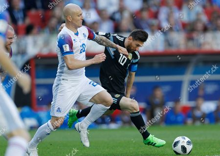 Argentina's Lionel Messi, right, vies for the ball with Iceland's Emil Hallfredsson during the group D match between Argentina and Iceland at the 2018 soccer World Cup in the Spartak Stadium in Moscow, Russia