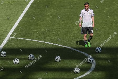 Lionel Messi of Argentina with the Adidas World Cup Footballs during warm  ... 69d7b87b759ca