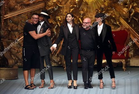 (L-R) Fashion designer Stefano Gabbana, British model Naomi Campbell, Italian actress Monica Bellucci, fashion designer Domenico Dolce and Dutch model Marpessa Hennink attend the show of Dolce and Gabbana during the Milan Men's Fashion Week, in Milan, Italy, 16 June 2018. The Milano Moda Uomo displays Spring/Summer 2019 collections and runs from 15 to 18 June.