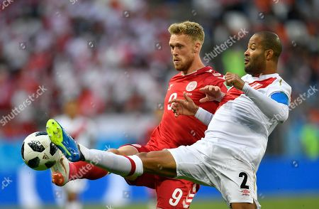 Alberto Rodriguez, Nicolai Jorgensen. Peru's Alberto Rodriguez, right, duels for the ball with Denmark's Nicolai Jorgensen during the group C match between Peru and Denmark at the 2018 soccer World Cup in the Mordovia Arena in Saransk, Russia