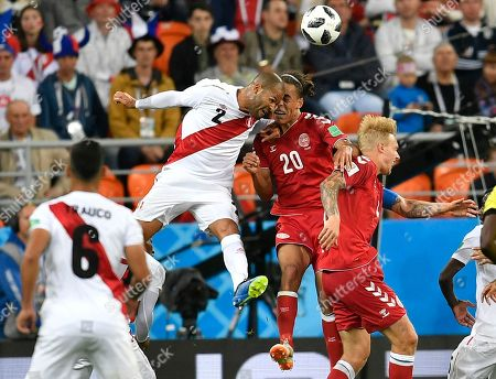 Alberto Rodriguez, Yussuf Yurary Poulsen. Peru's Alberto Rodriguez, second left, heads for the ball with Denmark's Yussuf Yurary Poulsen during the group C match between Peru and Denmark at the 2018 soccer World Cup in the Mordovia Arena in Saransk, Russia