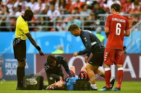 Denmark's William Kvist lies injured on the ground injured during the group C match between Peru and Denmark at the 2018 soccer World Cup in the Mordovia Arena in Saransk, Russia