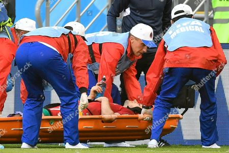 Denmark's William Kvist is carried on a stretcher after getting injury during the group C match between Peru and Denmark at the 2018 soccer World Cup in the Mordovia Arena in Saransk, Russia