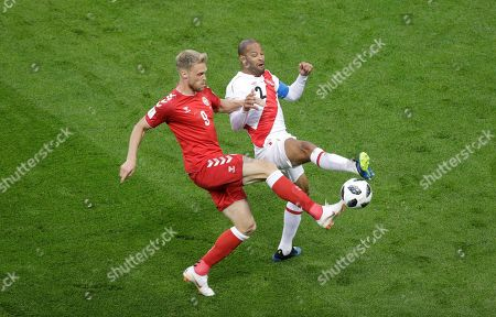 Nicolai Jorgensen, Alberto Rodriguez. Denmark's Nicolai Jorgensen, left, and Peru's Alberto Rodriguez, right, compete for the ball during the group C match between Peru and Denmark at the 2018 soccer World Cup in the Mordovia Arena in Saransk, Russia