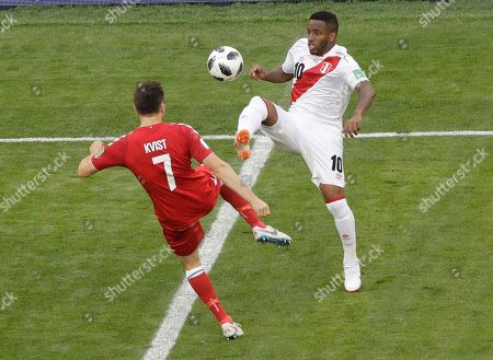 William Kvist, Jefferson Farfan. Denmark's William Kvist, left, and Peru's Jefferson Farfan compete for the ball during the group C match between Peru and Denmark at the 2018 soccer World Cup in the Mordovia Arena in Saransk, Russia