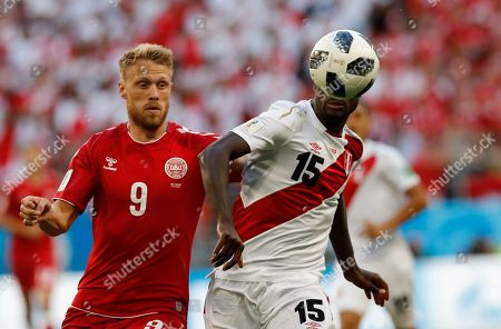 Denmark's Viktor Fischer, right, and Peru's Paolo Guerrero challenge for the ball during the group C match between Peru and Denmark at the 2018 soccer World Cup in the Mordovia Arena in Saransk, Russia
