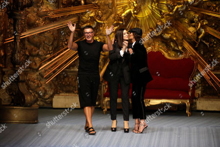 Stefano Gabbana, Marpessa Hennink, Monica Bellucci. Designer Stefano Gabbana, from left, actress Monica Bellucci and model Marpessa Hennink accept applause at the end of Dolce & Gabbana's men's 2019 Spring-Summer collection, unveiled during the Fashion Week in Milan, Italy