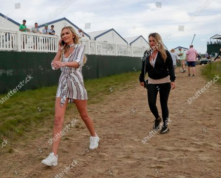 Paulina Gretzky walks along the course during the third round of the U.S. Open Golf Championship, in Southampton, N.Y