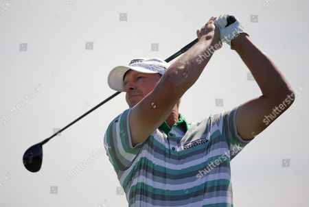 Steve Stricker plays his shot from the first tee during the third round of the U.S. Open Golf Championship, in Southampton, N.Y