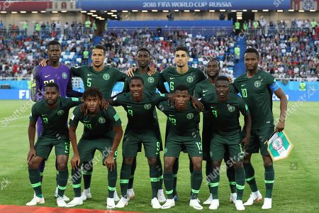 Stock Picture of Nigeria players pose for the media prior the group D match between Croatia and Nigeria at the 2018 soccer World Cup in the Kaliningrad Stadium in Kaliningrad, Russia, . Upper row from left: Nigeria goalkeeper Francis Uzoho, William Ekong, Wilfred Ndidi, Leon Balogun, Chidozie Awaziem and John Obi Mikel, lower row from left, Bryan Idowu, Alex Iwobi, Odion Ighalo, Abdullahi Shehu and Oghenekaro Etebo