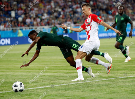 Nigeria's Abdullahi Shehu, left, defends against Croatia's Ivan Perisic the group D match between Croatia and Nigeria at the 2018 soccer World Cup in the Kaliningrad Stadium in Kaliningrad, Russia