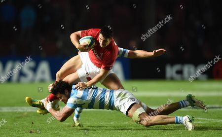 Owen Watkin of Wales is tackled by Santiago Gonzalez Iglesias of Argentina.