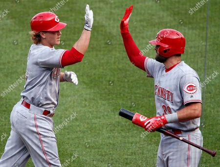 Brandon Dixon, Curt Casali. Cincinnati Reds' Brandon Dixon, left, is greeted by Curt Casali (38) after hitting a solo home run off Pittsburgh Pirates relief pitcher Richard Rodriguez in the ninth inning of a baseball game in Pittsburgh