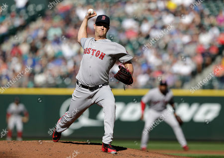 Boston Red Sox starting pitcher Steven Wright works against the Seattle Mariners during the first inning of a baseball game, in Seattle