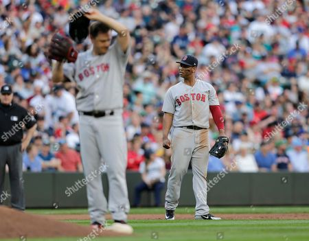 Rafael Devers, Steven Wright. Boston Red Sox third baseman Rafael Devers, right, reacts after committing and error as starting pitcher Steven Wright wipes his brow against the Seattle Mariners during a baseball game, in Seattle