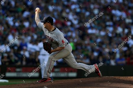 Boston Red Sox starting pitcher Steven Wright works against the Seattle Mariners during a baseball game, in Seattle