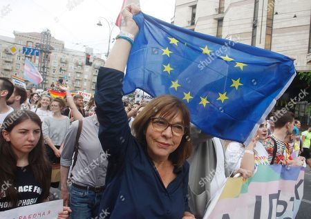 Stock Image of A member of the European Parliament from Alliance '90/The Greens German Rebecca Harms (C) takes part in the 'March of Equality Kiev Pride' gay pride parade in downtown Kiev, Ukraine, 17 June 2018. Representatives of LGBT (Lesbian, Gay, Bisexual and Transgender) organizations and their supporters took part in the 'March of Equality Kiev Pride' gay parade in the Ukrainian capital.