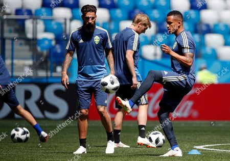 Sweden's Jimmy Durmaz (L) and Martin Olsson (R) attend a training session in Nihzny Novgorod, Russia, 17 June 2018. Sweden will face South Korea in a group F match of the FIFA World Cup 2018 on 18 June 2018.