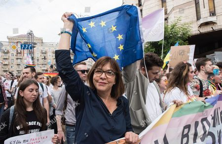 Rebecca Harms from Germany, member of the European Parliament, attends the annual Gay Pride parade, protected by riot police in Kiev, Ukraine, . Several thousand supporters of gay pride have held a march in Ukrainian capital that lasted about 20 minutes despite opponents attempts to block them