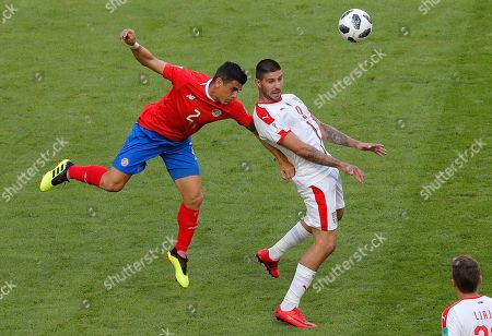 Serbia's Aleksandar Mitrovic, right, vies for the ball with Costa Rica's Johnny Acosta during the group E match between Costa Rica and Serbia at the 2018 soccer World Cup in the Samara Arena in Samara, Russia